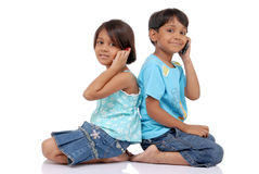 Brother and sister with mobile Royalty Free Stock Images