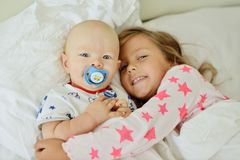 Brother and sister in the morning Royalty Free Stock Photo