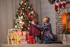 Brother and sister near the Christmas tree stock photography