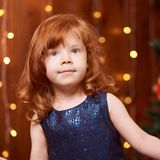 Brother and sister. New Year xmas child. Christmas eve holiday. interior. Beautiful little girl. Blue dress royalty free stock photos