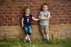 Brother and sister outdoor portrait. Portrait of cute brother and sister Stock Photo
