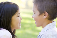 Brother and sister outdoors Royalty Free Stock Photos