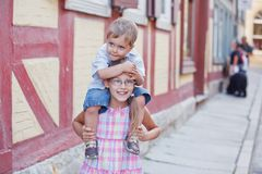 Brother and sister outdoors in city Royalty Free Stock Photo