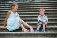 Brother and sister outdoors in city Royalty Free Stock Photography