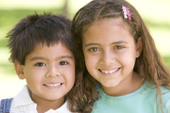Brother and sister outdoors smiling stock images