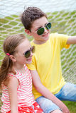 Brother and sister outdoors Stock Photos