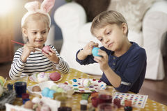 Brother and sister painting Easter eggs Royalty Free Stock Image