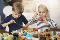 Brother and sister painting Easter eggs Royalty Free Stock Photography