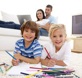 Brother and sister painting in living-room Royalty Free Stock Photo