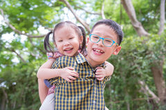 Brother and sister in park Royalty Free Stock Image