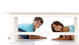 Brother and sister peeping Royalty Free Stock Image