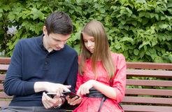 Brother and sister with phone Royalty Free Stock Photo