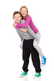 Brother and sister piggyback Stock Images
