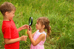 Brother and sister play with big black loop Royalty Free Stock Images