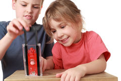 Brother and sister play with guillotine Royalty Free Stock Photo