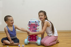 Brother and sister play with toys. Boy girl Stock Photography