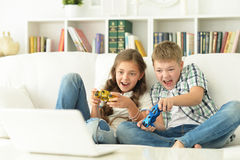 Brother and sister play videogames Stock Photography