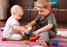 Brother and sister playing Royalty Free Stock Photos