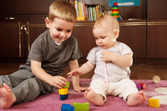 Brother and sister playing Royalty Free Stock Images