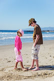 Brother & sister playing beach Royalty Free Stock Image