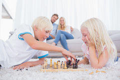 Brother and sister playing chess Royalty Free Stock Images