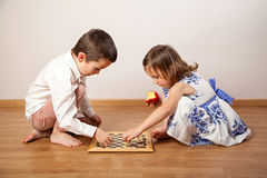 Brother and sister playing chess Stock Photography