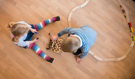 Brother and sister playing with chess. Photo from above Royalty Free Stock Photography