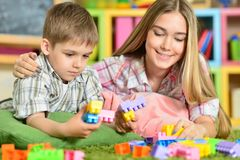 Brother and sister  playing. With colorful plastic blocks Stock Photography
