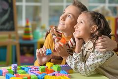 Brother and sister playing. With colorful plastic blocks together Royalty Free Stock Image