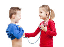 Brother and sister playing a doctor Stock Images
