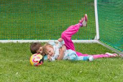Brother and sister are playing on the football field Stock Photo