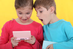 Brother and sister playing games Royalty Free Stock Photo