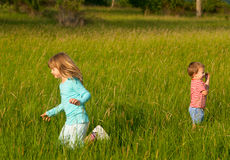 Brother and sister playing on the meadow Stock Image
