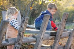 Brother and sister playing outdoors Royalty Free Stock Photo
