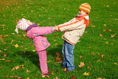 Brother and sister playing in the park Stock Images