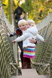 Brother and sister playing in the park Stock Photography