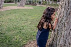 Girl playing in a park outdoors. stock photography