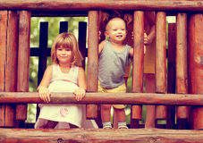 Brother and sister playing on the playground Stock Photography
