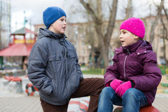 Brother and sister playing at the playground Royalty Free Stock Photography