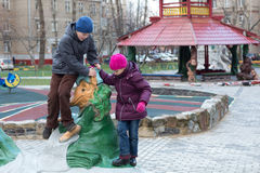 Brother and sister playing in the playground. With sculptures made by Krylovs fables royalty free stock photo