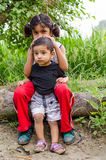 Brother sister playing sitting at countryside Royalty Free Stock Images