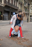 Brother and sister playing on the street Royalty Free Stock Images