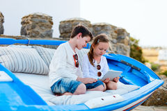 Brother and sister playing on tablet device Royalty Free Stock Photography
