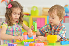 Brother and sister playing together. Brother and sister playing with colorful plastic blocks together Stock Photography