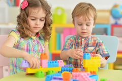 Brother and sister playing together. Brother and sister playing with colorful plastic blocks together Royalty Free Stock Photos