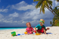 Brother and sister playing on tropical beach Stock Photography