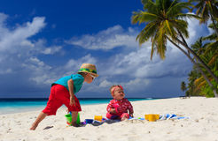 Brother and sister playing on tropical beach Royalty Free Stock Images