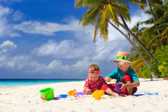 Brother and sister playing on tropical beach Stock Images