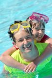 Brother and sister in the pool Stock Photography