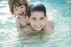 Brother and sister in the pool Stock Photos